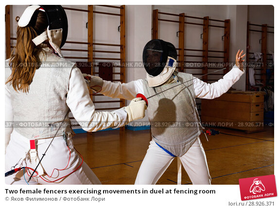 Купить «Two female fencers exercising movements in duel at fencing room», фото № 28926371, снято 11 июля 2018 г. (c) Яков Филимонов / Фотобанк Лори