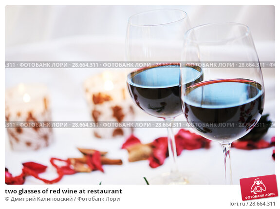 Купить «two glasses of red wine at restaurant», фото № 28664311, снято 12 октября 2016 г. (c) Дмитрий Калиновский / Фотобанк Лори