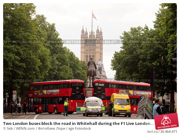 Two London buses block the road in Whitehall during the F1 LiveLondon... (2017 год). Редакционное фото, фотограф Seb / WENN.com / age Fotostock / Фотобанк Лори