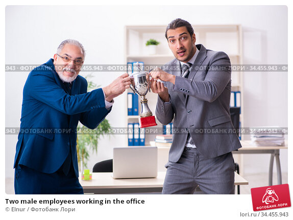 Two male employees working in the office. Стоковое фото, фотограф Elnur / Фотобанк Лори