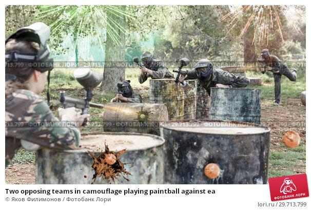 Купить «Two opposing teams in camouflage playing paintball against ea», фото № 29713799, снято 22 сентября 2018 г. (c) Яков Филимонов / Фотобанк Лори