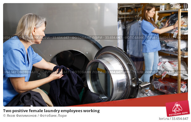 Купить «Two positive female laundry employees working», фото № 33654647, снято 22 января 2019 г. (c) Яков Филимонов / Фотобанк Лори