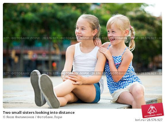 Купить «Two small sisters looking into distance», фото № 28576927, снято 20 июля 2017 г. (c) Яков Филимонов / Фотобанк Лори