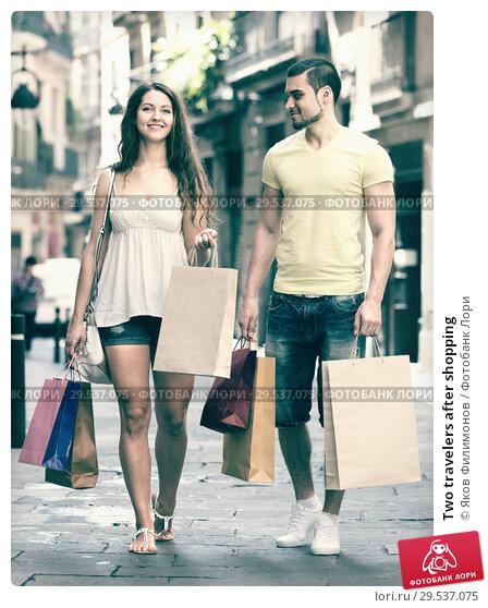 Купить «Two travelers after shopping», фото № 29537075, снято 11 июня 2014 г. (c) Яков Филимонов / Фотобанк Лори