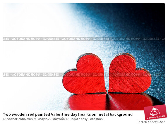 Two wooden red painted Valentine day hearts on metal background. Стоковое фото, фотограф Zoonar.com/Ivan Mikhaylov / easy Fotostock / Фотобанк Лори