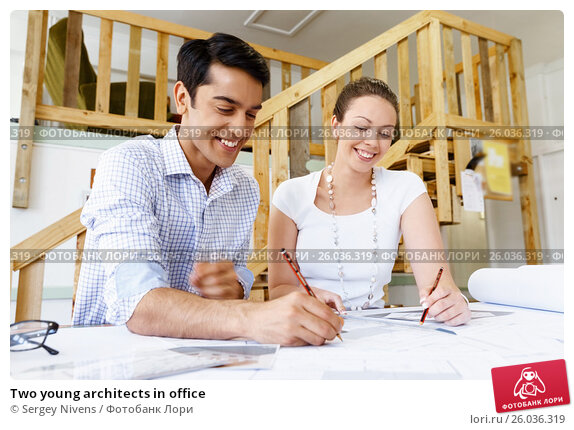 Two young architects in office, фото № 26036319, снято 5 ноября 2014 г. (c) Sergey Nivens / Фотобанк Лори