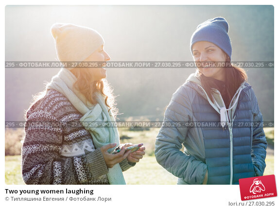 Two young women laughing, фото № 27030295, снято 26 сентября 2017 г. (c) Типляшина Евгения / Фотобанк Лори