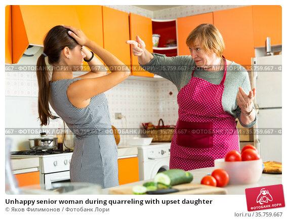 Unhappy senior woman during quarreling with upset daughter. Стоковое фото, фотограф Яков Филимонов / Фотобанк Лори