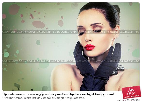 Upscale woman wearing jewellery and red lipstick on light background. Стоковое фото, фотограф Zoonar.com/Zdenka Darula / easy Fotostock / Фотобанк Лори