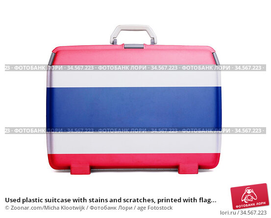Used plastic suitcase with stains and scratches, printed with flag... Стоковое фото, фотограф Zoonar.com/Micha Klootwijk / age Fotostock / Фотобанк Лори