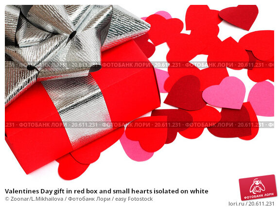 valentines day gift in red box and small hearts isolated on
