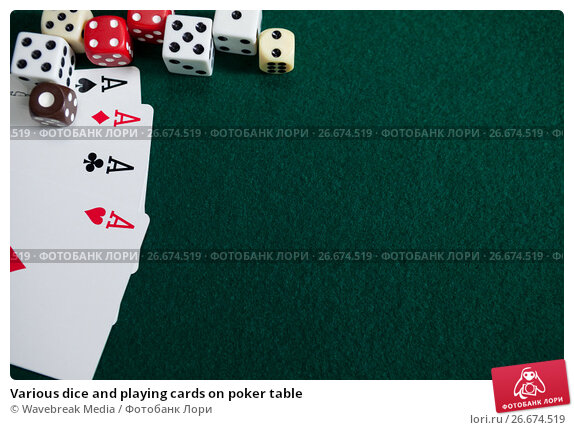 Купить «Various dice and playing cards on poker table», фото № 26674519, снято 6 апреля 2017 г. (c) Wavebreak Media / Фотобанк Лори