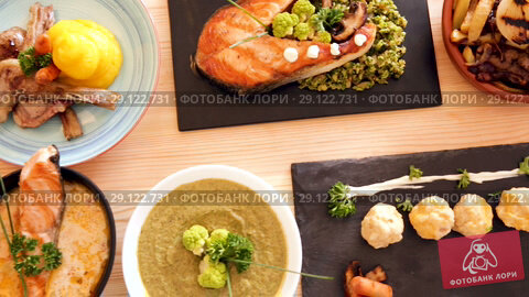 Купить «Various dishes of traditional Norwegian cuisine served with vegetables and herbs», видеоролик № 29122731, снято 27 августа 2018 г. (c) Яков Филимонов / Фотобанк Лори