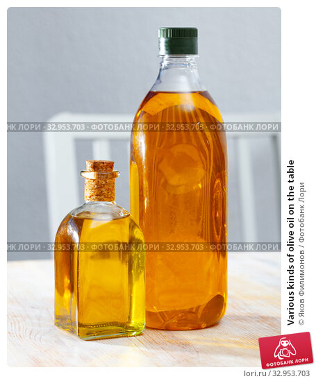 Various kinds of olive oil on the table. Стоковое фото, фотограф Яков Филимонов / Фотобанк Лори