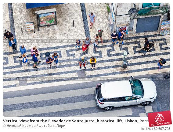 Купить «Vertical view from the Elevador de Santa Justa, historical lift, Lisbon, Portugal,», фото № 30607703, снято 15 июля 2018 г. (c) Николай Коржов / Фотобанк Лори