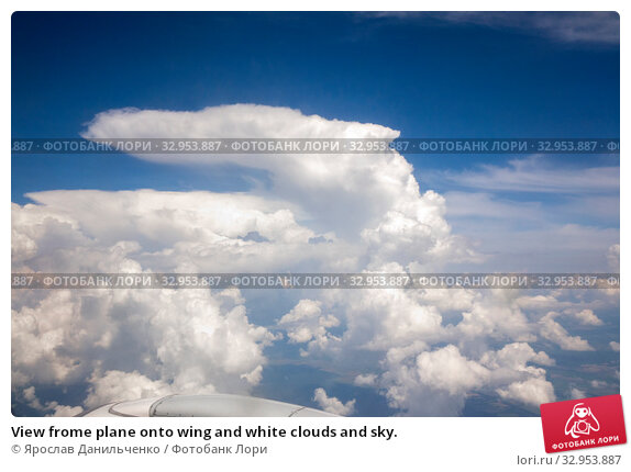 View frome plane onto wing and white clouds and sky. Стоковое фото, фотограф Ярослав Данильченко / Фотобанк Лори