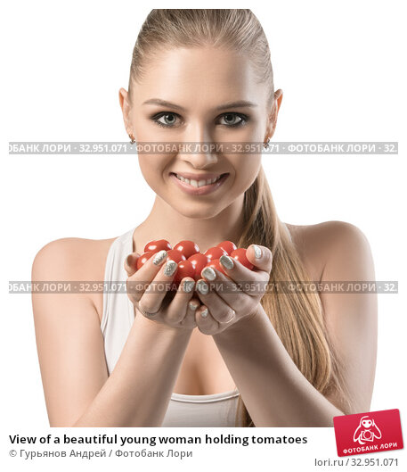 View of a beautiful young woman holding tomatoes. Стоковое фото, фотограф Гурьянов Андрей / Фотобанк Лори