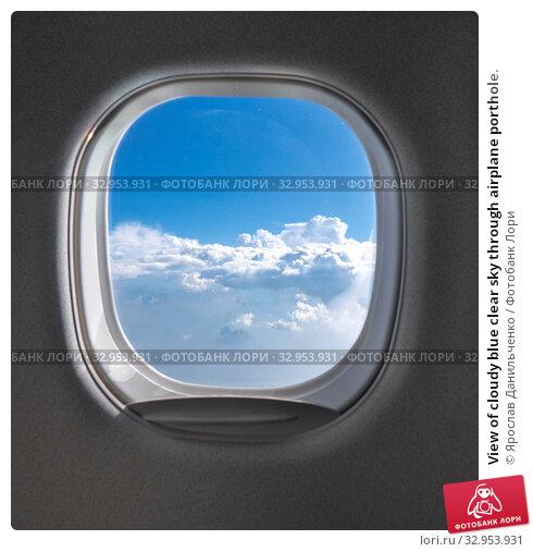 View of cloudy blue clear sky through airplane porthole. Стоковое фото, фотограф Ярослав Данильченко / Фотобанк Лори