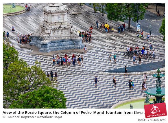 Купить «View of the Rossio Square, the Column of Pedro IV and  fountain from Elevador Santa Justa (Santa Justa Lift).  Lisbon, Portugal,», фото № 30607695, снято 15 июля 2018 г. (c) Николай Коржов / Фотобанк Лори