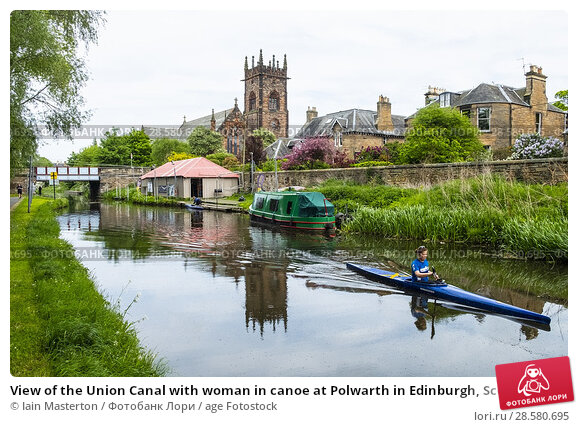 Купить «View of the Union Canal with woman in canoe at Polwarth in Edinburgh, Scotland, United Kingdom.», фото № 28580695, снято 21 мая 2018 г. (c) age Fotostock / Фотобанк Лори