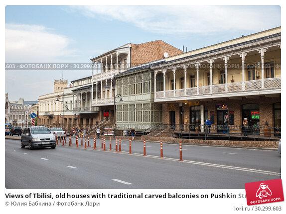 Купить «Views of Tbilisi, old houses with traditional carved balconies on Pushkin Street», фото № 30299603, снято 22 сентября 2018 г. (c) Юлия Бабкина / Фотобанк Лори