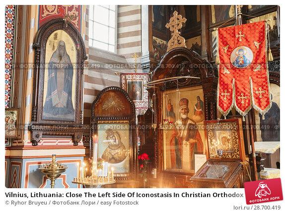 Купить «Vilnius, Lithuania: Close The Left Side Of Iconostasis In Christian Orthodox Church Of Saint Nicholas.», фото № 28700419, снято 4 июля 2016 г. (c) easy Fotostock / Фотобанк Лори
