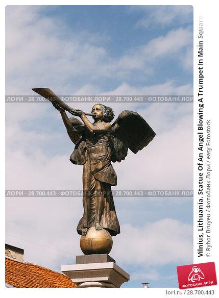 Купить «Vilnius, Lithuania. Statue Of An Angel Blowing A Trumpet In Main Square Against A Sunny Blue Sky In Uzupis District. Uzupio Republic Or Uzupis Is A Cultural Artistic District, Popular Tourist Place.», фото № 28700443, снято 5 июля 2016 г. (c) easy Fotostock / Фотобанк Лори