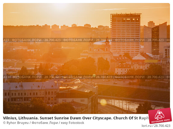 Купить «Vilnius, Lithuania. Sunset Sunrise Dawn Over Cityscape. Church Of St Raphael The Archangel And Former Jesuit Monastery. Business District New City Centre Shnipishkes.», фото № 28700423, снято 5 июля 2016 г. (c) easy Fotostock / Фотобанк Лори