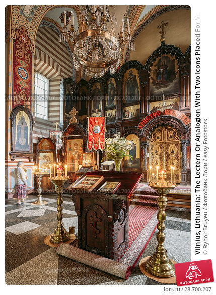 Купить «Vilnius, Lithuania: The Lectern Or Analogion With Two Icons Placed For Veneration By The Faithful In Orthodox Church Of St. Nicholas.», фото № 28700207, снято 4 июля 2016 г. (c) easy Fotostock / Фотобанк Лори
