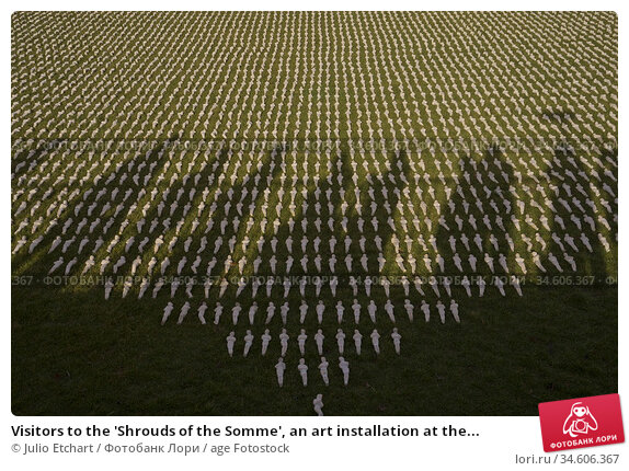 Visitors to the 'Shrouds of the Somme', an art installation at the... (2018 год). Редакционное фото, фотограф Julio Etchart / age Fotostock / Фотобанк Лори