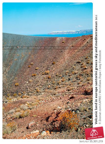 Volcanic land in europe santorini greece sky and mediterranean sea. Стоковое фото, фотограф Zoonar.com/LKPRO / easy Fotostock / Фотобанк Лори