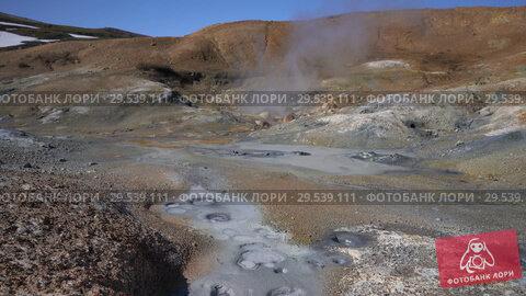 Купить «Volcanic landscape of Kamchatka: hot springs surrounded by active fumaroles», видеоролик № 29539111, снято 26 сентября 2018 г. (c) А. А. Пирагис / Фотобанк Лори