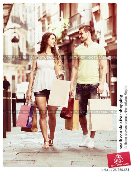 Купить «Walk couple after shopping», фото № 26760631, снято 11 июня 2014 г. (c) Яков Филимонов / Фотобанк Лори