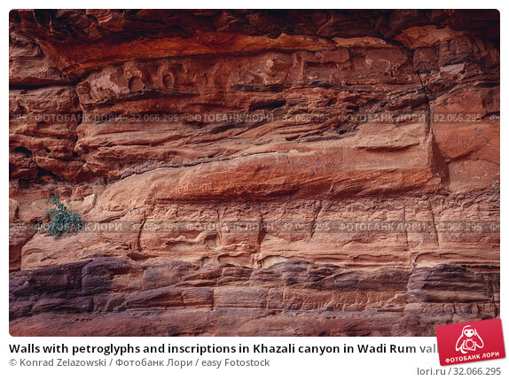 Walls with petroglyphs and inscriptions in Khazali canyon in Wadi Rum valley also called Valley of the Moon in Jordan. Стоковое фото, фотограф Konrad Zelazowski / easy Fotostock / Фотобанк Лори