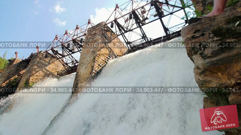 Water dam - heavy river water stream falls down - beautiful nature. Стоковое видео, видеограф Константин Шишкин / Фотобанк Лори