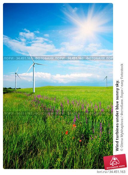 Wind turbines under blue sunny sky. Стоковое фото, фотограф Olena Mykhaylova / easy Fotostock / Фотобанк Лори