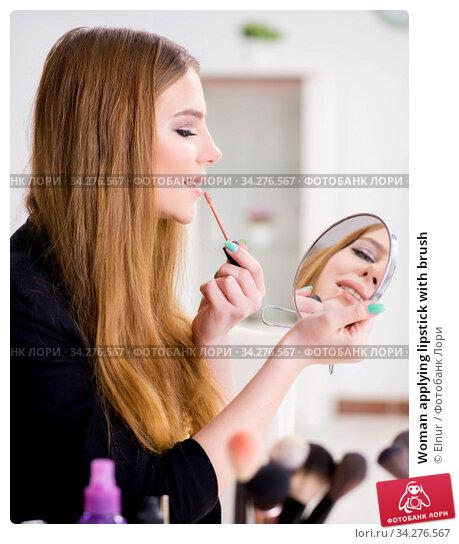 Woman applying lipstick with brush. Стоковое фото, фотограф Elnur / Фотобанк Лори