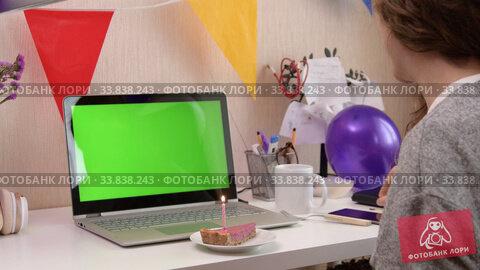 Купить «Woman celebrating birthday from home», видеоролик № 33838243, снято 19 апреля 2020 г. (c) Сергей Петерман / Фотобанк Лори