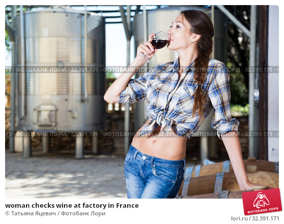 Купить «woman checks wine at factory in France», фото № 32391171, снято 19 ноября 2019 г. (c) Татьяна Яцевич / Фотобанк Лори