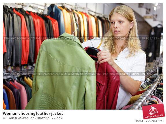 Купить «Woman choosing leather jacket», фото № 29961199, снято 5 сентября 2018 г. (c) Яков Филимонов / Фотобанк Лори