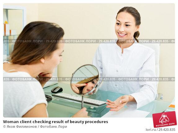 Купить «Woman client checking result of beauty procedures», фото № 29420835, снято 24 апреля 2019 г. (c) Яков Филимонов / Фотобанк Лори