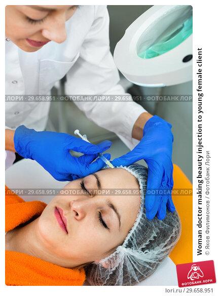 Купить «Woman doctor making beauty injection to young female client», фото № 29658951, снято 22 февраля 2019 г. (c) Яков Филимонов / Фотобанк Лори