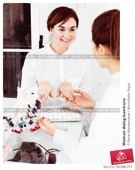 Купить «Woman doing manicure», фото № 28646311, снято 2 февраля 2017 г. (c) Яков Филимонов / Фотобанк Лори