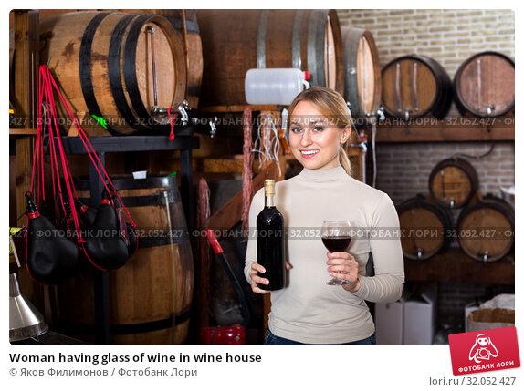 Woman having glass of wine in wine house. Стоковое фото, фотограф Яков Филимонов / Фотобанк Лори