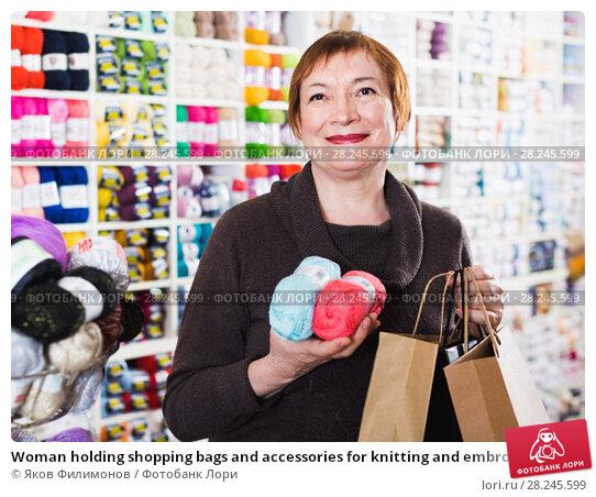 Купить «Woman holding shopping bags and accessories for knitting and embroidery», фото № 28245599, снято 10 мая 2017 г. (c) Яков Филимонов / Фотобанк Лори