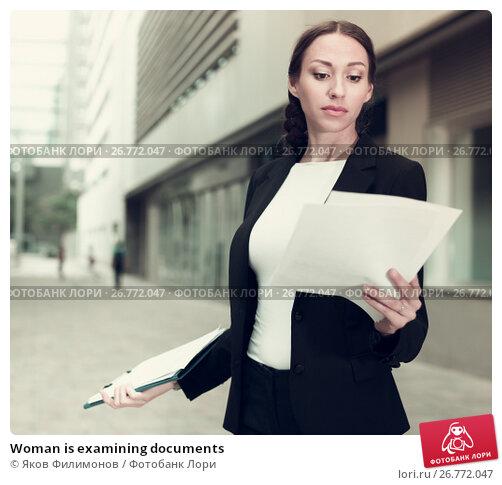 Купить «Woman is examining documents», фото № 26772047, снято 26 июня 2017 г. (c) Яков Филимонов / Фотобанк Лори