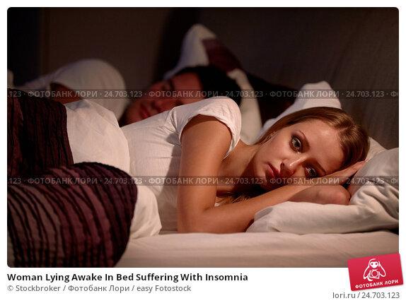 Купить «Woman Lying Awake In Bed Suffering With Insomnia», фото № 24703123, снято 1 июля 2014 г. (c) easy Fotostock / Фотобанк Лори