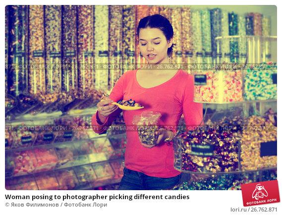 Woman posing to photographer picking different candies, фото № 26762871, снято 22 марта 2017 г. (c) Яков Филимонов / Фотобанк Лори
