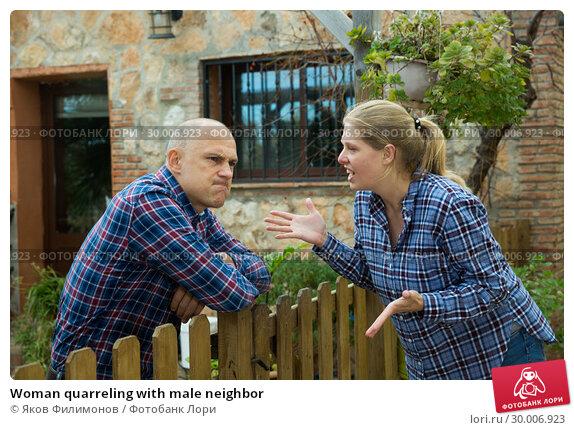 Купить «Woman quarreling with male neighbor», фото № 30006923, снято 15 декабря 2018 г. (c) Яков Филимонов / Фотобанк Лори