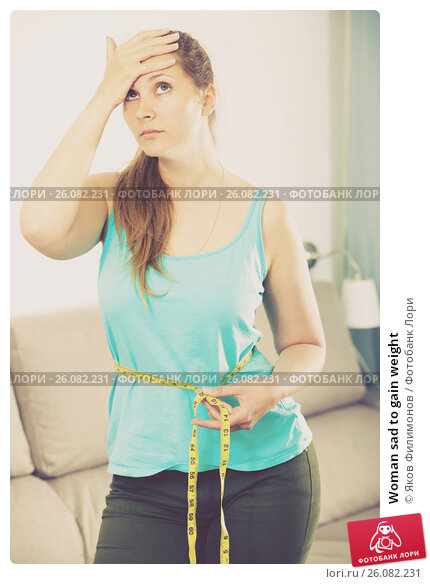 Купить «Woman sad to gain weight», фото № 26082231, снято 21 марта 2017 г. (c) Яков Филимонов / Фотобанк Лори